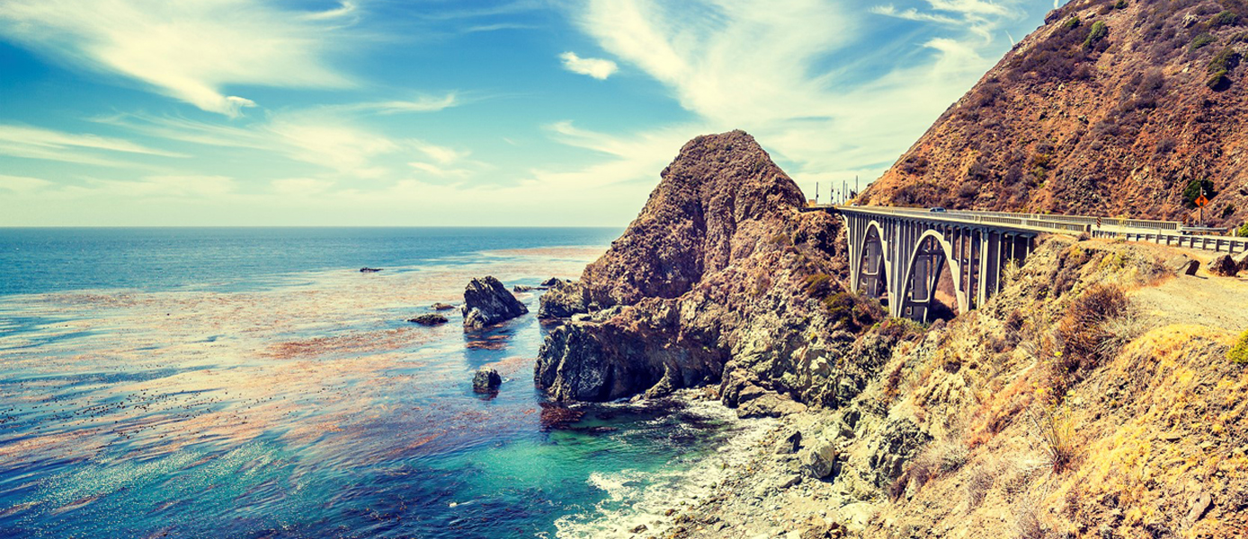 Vintage stylized California coastline along Pacific Coast Highwa